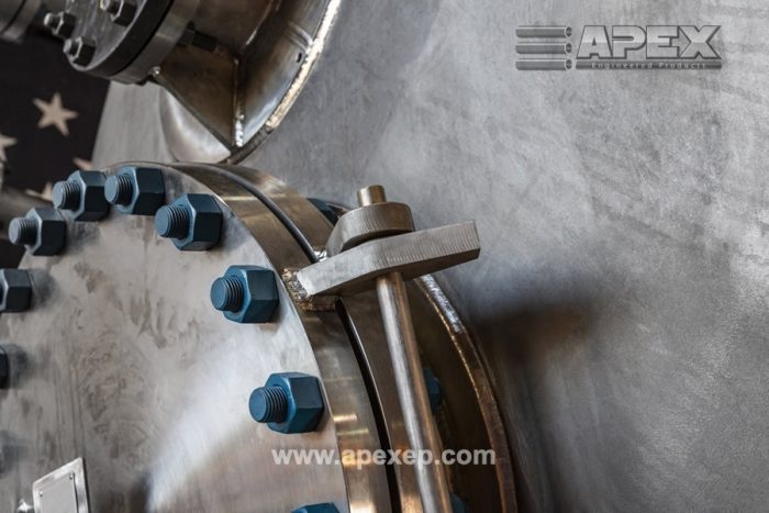Closeup of a titanium tank built by Apex Engineered Products - Photo 3