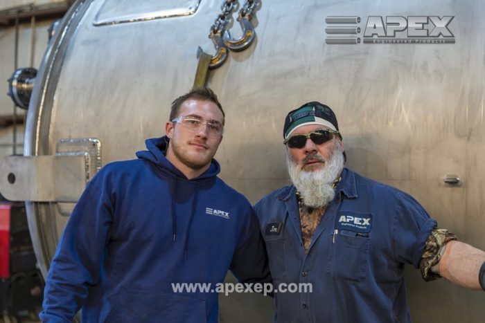 Eric (L) and Jim (R) next to the titanium vessel built by Apex Engineered Products