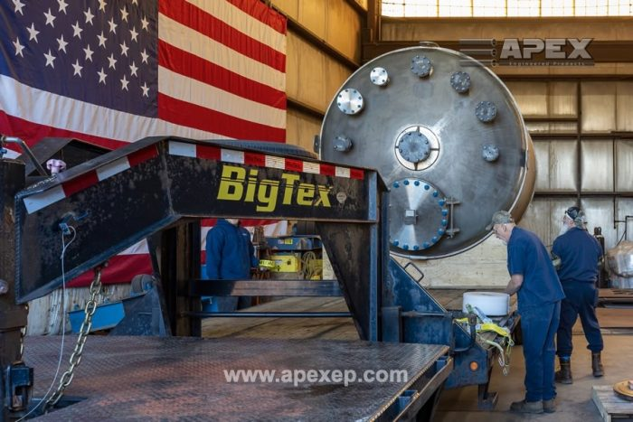 Titanium tank is being carefully loaded for shipment